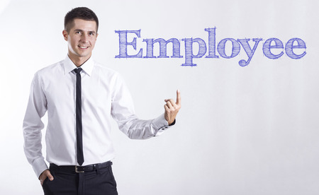 Employee - Young smiling businessman pointing on text - horizontal images