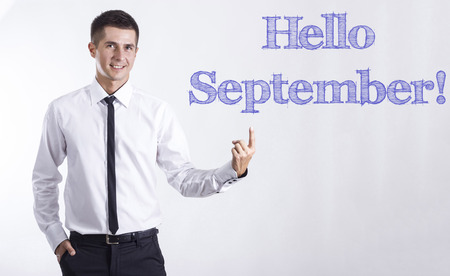 Hello September! - Young smiling businessman pointing on text - horizontal images