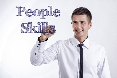 People Skills - Young smiling businessman writing on transparent surface - horizontal images Stok Fotoğraf