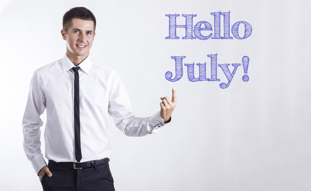 Hello July! - Young smiling businessman pointing on text - horizontal images Stok Fotoğraf