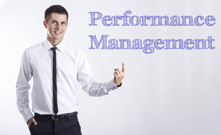 Performance Management - Young smiling businessman pointing on text - horizontal images