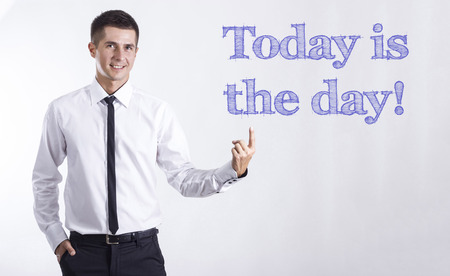 Today is the day! - Young smiling businessman pointing on text - horizontal images