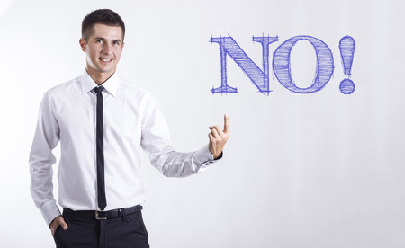 NO! - Young smiling businessman pointing on text - horizontal images