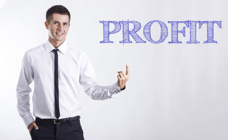 PROFIT - Young smiling businessman pointing on text - horizontal images