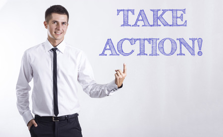 TAKE ACTION! - Young smiling businessman pointing on text - horizontal images