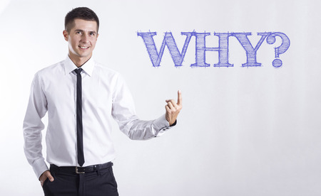 WHY? - Young smiling businessman pointing on text - horizontal images Stok Fotoğraf
