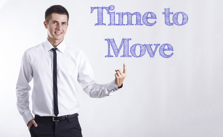 Time to Move - Young smiling businessman pointing on text - horizontal images Stok Fotoğraf