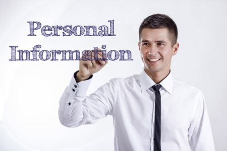 Personal Information - Young smiling businessman writing on transparent surface - horizontal images