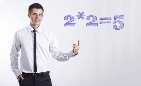 2- Young smiling businessman pointing on text2=5 - Young smiling businessman pointing on text - horizontal images
