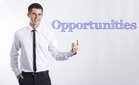 Opportunities - Young smiling businessman pointing on text - horizontal images