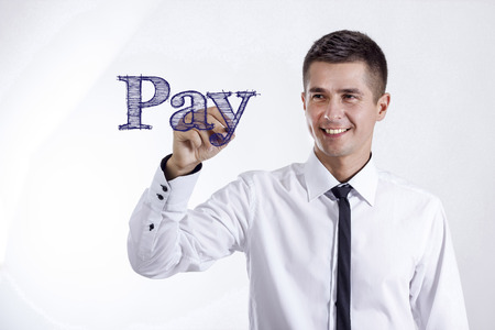 Pay - Young smiling businessman writing on transparent surface - horizontal images