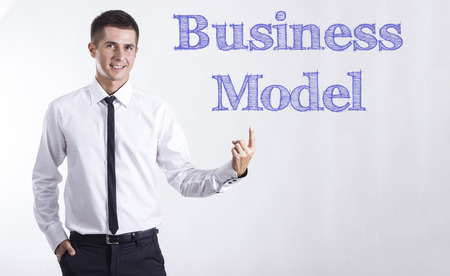 Business Model - Young smiling businessman pointing on text - horizontal images Stok Fotoğraf