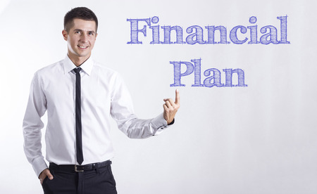 Financial Plan - Young smiling businessman pointing on text - horizontal images Stok Fotoğraf