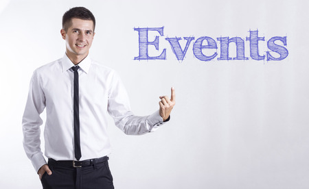 Events - Young smiling businessman pointing on text - horizontal images Stok Fotoğraf
