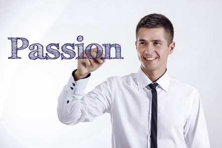 Passion - Young smiling businessman writing on transparent surface - horizontal images