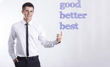 良い良いベスト - ヤング本文を指してビジネスマンの笑みを浮かべて - 水平画像