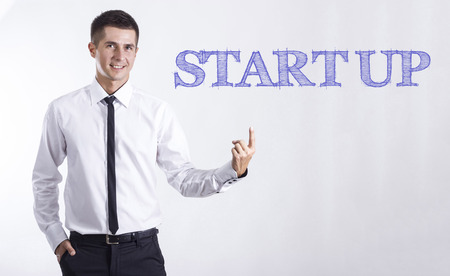 START UP - Young smiling businessman pointing on text - horizontal images Stok Fotoğraf