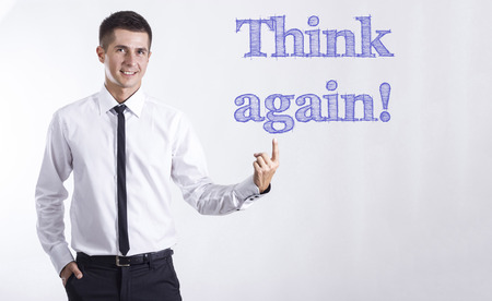 Think again! - Young smiling businessman pointing on text - horizontal images