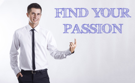 FIND YOUR PASSION - Young smiling businessman pointing on text - horizontal images Stok Fotoğraf