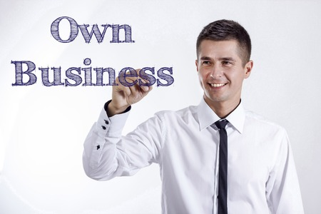 Own Business - Young smiling businessman writing on transparent surface - horizontal images Stok Fotoğraf