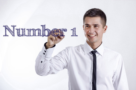 Number 1 - Young smiling businessman writing on transparent surface - horizontal images