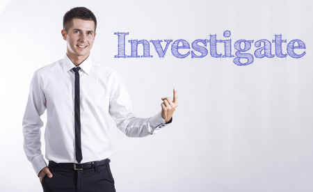 Investigate - Young smiling businessman pointing on text - horizontal images