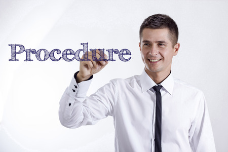 Procedure - Young smiling businessman writing on transparent surface - horizontal images