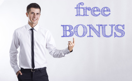 Free BONUS - Young smiling businessman pointing on text - horizontal images