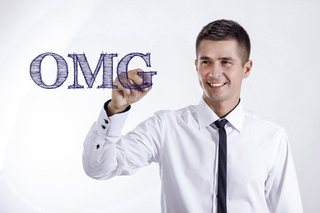 OMG - Young smiling businessman writing on transparent surface - horizontal images