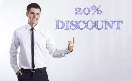 20% 割引 - 本文 - 水平方向の画像を指してビジネスマンを笑顔若い 写真素材