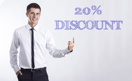 20% DISCOUNT - Young smiling businessman pointing on text - horizontal images