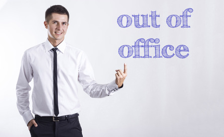 out of office - Young smiling businessman pointing on text - horizontal images Stok Fotoğraf
