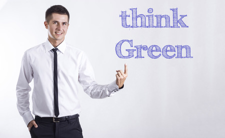 Think Green! - Young smiling businessman pointing on text - horizontal images