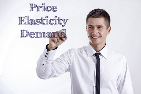 Price Elasticity Demand - Young smiling businessman writing on transparent surface - horizontal images