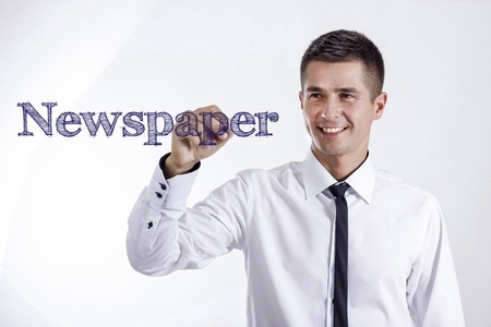 Newspaper - Young smiling businessman writing on transparent surface - horizontal images
