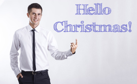 Hello Christmas! - Young smiling businessman pointing on text - horizontal images Banque d'images