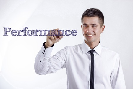 Performance - Young smiling businessman writing on transparent surface - horizontal images Stock Photo