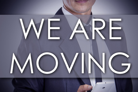 WE ARE MOVING - Young businessman with text - business concept - horizontal image