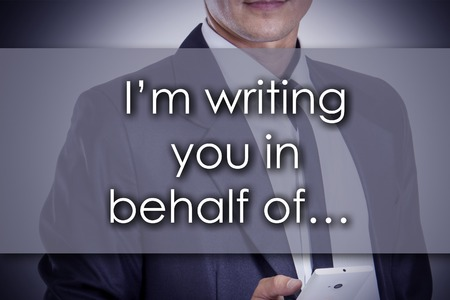 I'm writing you in behalf of…  - Young businessman with text - business concept - horizontal image 版權商用圖片