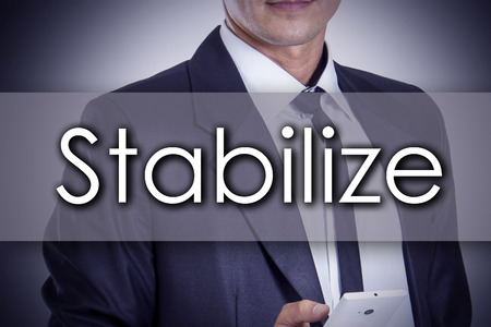 Stabilize - Young businessman with text - business concept - horizontal image