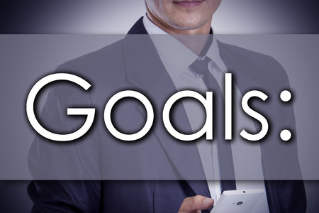 Goals: - Young businessman with text - business concept - horizontal image