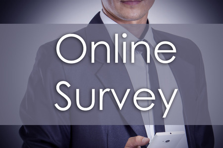 summarize: Online Survey - Young businessman with text - business concept - horizontal image Stock Photo