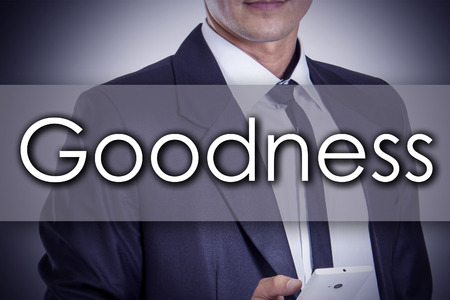 goodness: Goodness - Young businessman with text - business concept - horizontal image Stock Photo