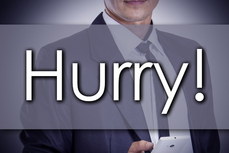 Hurry! - Young businessman with text - business concept - horizontal image Stock Photo