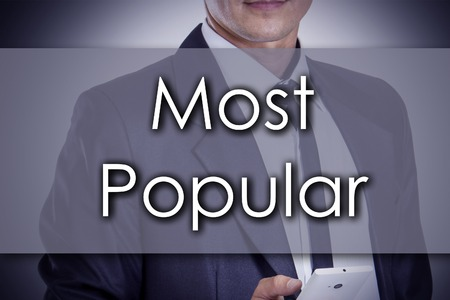 most popular: Most Popular - Young businessman with text - business concept - horizontal image Stock Photo
