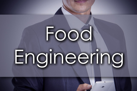 finger fish: Food Engineering - Young businessman with text - business concept - horizontal image Stock Photo