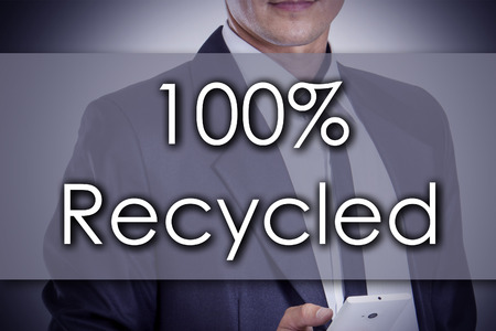 completely: 100% Recycled - Young businessman with text - business concept - horizontal image Stock Photo