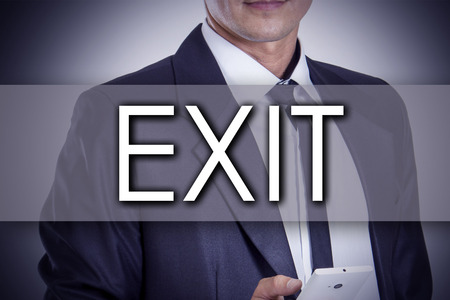 evacuate: EXIT - Young businessman with text - business concept - horizontal image Stock Photo