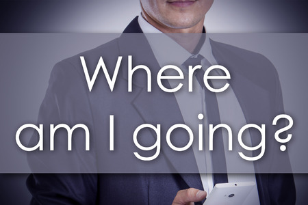 where to go: Where am I going? - Young businessman with text - business concept - horizontal image Stock Photo