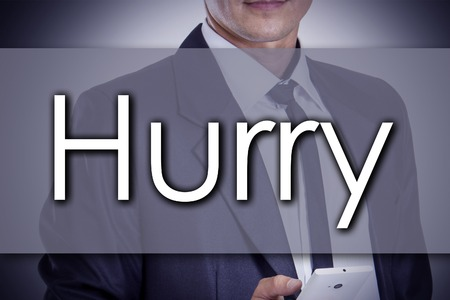 Hurry - Young businessman with text - business concept - horizontal image Stock Photo